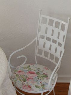 My living room Sept 2013  Shabby Sweet Vintage Romantic Prairie Farmhouse Cottage....Enjoy!!!! Amy (Mom to the Four Sisters In A Cottage) Old Wrought Iron Chairs spray painted white and recovered with Pink Roses Ralph Lauren Fabric They weigh about 20 pounds each.