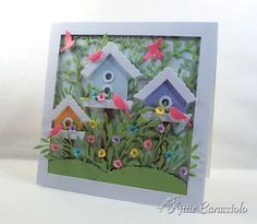 Spring is in the air and I love creating colorful scene cards with die cut bird houses. I have a little secret. I didn't use a birdhouse die set to create my colorful bird houses. And, I have a surpri