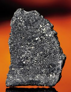 The rarest of all meteorites is from Mars.  The rock was ejected from Mars by an impact of a meteor or comet, and eventually fell to earth.  The are only 120 known speciens.  This particular rock is Chassignite.