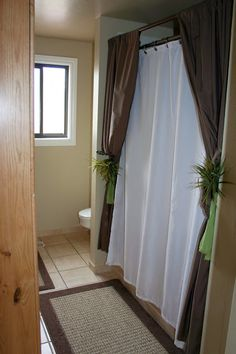 Put a curtain rod above the other rod and hve curtains edge the bathtub