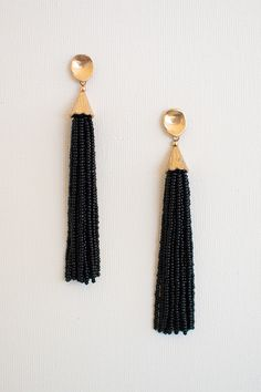 Bead all about it: there's not much explaining to do about these G O R G E O U S black beaded earrings. Dangle style featured from a gold, stud style piece. Post style back. Add these beauties to any