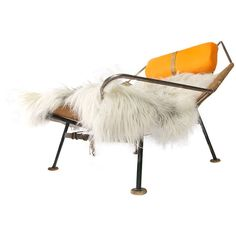 Flag Halyard Chair by Hans Wegner c.1952 | From a unique collection of antique and modern lounge chairs at http://www.1stdibs.com/furniture/seating/lounge-chairs/  I'd say 52 pins qualifies as a fan fave, no?