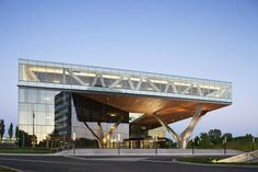 The project's unique structure utilizes an asymmetrical tree-column and truss to support an extended fourth floor, providing a signature element for the project. A rectangular hole is carved in that floor to allow the sun to shower the ground level grand entry plaza with light. http://www.archello.com/en/project/centra-metropark
