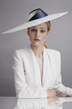 Folded glass fedora | Sophie Beale Millinery | Natural collection, Spring-Summer 2015 | Carefully selected innovative materials from acrylic set rose petals to portrait linen, lacquered wool and glass fabric set these pieces apart whilst retaining a sophisticated wearable aesthetic