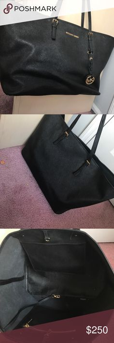 Black Jet set Michael Kors Tote Black bag used 2 times as a carry on travel bag. Great material easy to clean perfect condition. Michael Kors Bags Totes