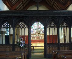 Minehead: the 15th-century rood screen is similar in design to those of Carhampton and Dunster. The tracery is grouped under two subarches with a lattice of quatrefoils in the head.