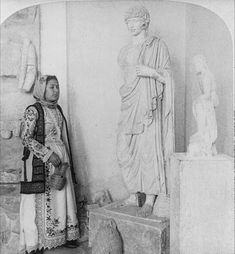 An ancient youth [statue] and modern maiden of Eleusis, Greece. Created / Published Stereo copyrighted by Underwood & Undewrood. Library of Congress Prints and Photographs Division Washington, D.