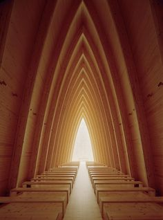 ST. HENRY'S ECUMENICAL ART CHAPEL  TURKU/#FINLAND; the spare, arc interior simply and effectively allows for one's purpose to be explored.