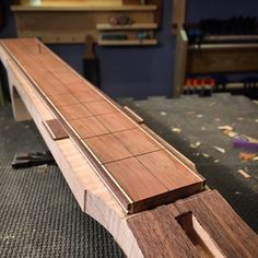Yesterday I slotted and bound the #fretboard. As with the rest of the #guitar, the #binding is pretty simple in #walnut and #holly. I'm kind of in love with the #pear #fingerboard. This will be my...