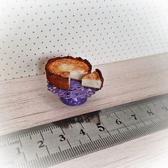 Baked cheese cake with metal cake stand.