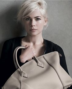 Michelle Williams with the Louis Vuitton Lockit Handbag