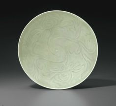 A rare large Longquan celadon carved bowl, China, Southern Song Dynasty (1127-1279)