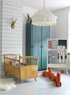 chambre bébé pour un garçon jolies couleurs, tête de lit intéressante