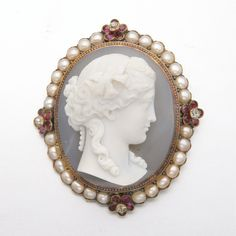 GOLD, HARDSTONE CAMEO, PEARL, RUBY AND DIAMOND BROOCH, MID-19TH CENTURY