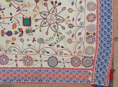 Antique Indian Kantha Embroidery Quilt. From the West Bengal region of India. 59 x 39 inches. Wonderful, kinetic design in good condition. Pinwheels, flowers, cannon, Bengali inscription (unknown translation). Nice, colorful running  ...