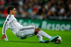 Raphael Varane Photos Photos - Raphael Varane of Real Madrid CF saves the ball during the UEFA Champions League Group B match between Real Madrid CF and Liverpool FC at Estadio Santiago Bernabeu on November 4, 2014 in Madrid, Spain. - Real Madrid CF v Liverpool FC