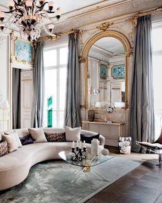 A Vladimir Kagan sofa anchors the living room of a Paris apartment designed by Klavs Rosenflack. | Photo: Nicolas Mathéus