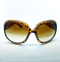 Leopard print oval shaped sunglasses featuring UVA/UVB 400 protection for round, oval, long or square faces.