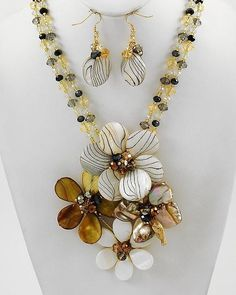 """CHUNKY NATURAL SHELL FLOWER THEME GOLD TONE NECKLACE SET WITH GLASS ACCENTS     * If you need a necklace extender I have them for sale in my store.*        NECKLACE: 20"""" + EXT    CHARM: 4 5/8"""" LONG    LOBSTER CLAW CLOSURE       HOOK EARRINGS: 2 1/8"""" LONG           COLOR: GOLD TONE  $29.99"""