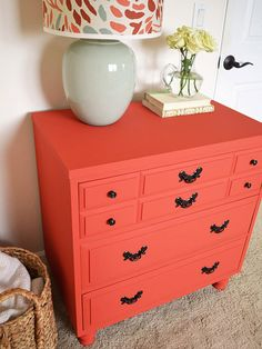 To start, Sarah removed the water-damaged bottom and raised the dresser off the ground with a new set of legs. She then mixed two shades of chalk-finish paint to create a custom coral that really pops in her guest room. Finally, she updated the hardware with a coat of metallic spray paint. /