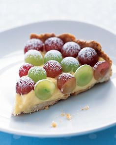 Grape Tart - A hearty, lightly sweetened oat crust supports rich vanilla pastry cream and fresh red and green grapes in this unique fall dessert. Create a pattern on top of the tart with the different colors of grapes. Elegant Desserts, Just Desserts, Delicious Desserts, Yummy Food, Fall Desserts, Healthy Food, Grape Tart Recipes, Fruit Recipes, Grape Recipes Dessert