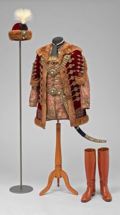 Gaudy or gorgeous? Ceremonial Garment of a Hungarian Magnate, Hungarian, c. 1865, silk, velvet, fur, gold passementerie, gilded silver, enamel, mother-of-pearl, turquoise, and plumes; boots: leather; saber: steel, metal, velvet, gemstones, and leather; Kunsthistorisches Museum, Vienna. Photo via MFAH (@MFAH) on Twitter. See also: http://www.mfah.org/blogs/inside-mfah/2015/habsburg-chic/