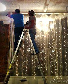 behind the head table? Hang a vertical string of lights from a rod and add the sheer to soften it. This would go great at the window that already has sheer window panels and a curtain rod!