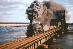 Erie Berkshire 2-8-4 steam locomotive # 3376, is seen hauling a freight train across a mainline railroad bridge in Hackensack, New Jersey, 10-23-1949