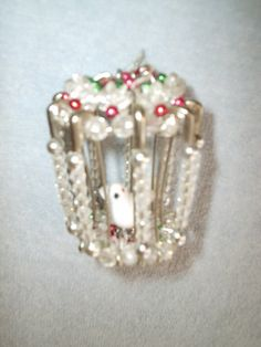 Charming Handmade Pearl and Safety Pin Birdcage Ornament Holiday Christmas Decor. $6.00, via Etsy.