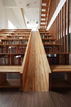petapeta:  Playful Wooden Slide Formed Within a Bookshelf - My Modern Metropolis