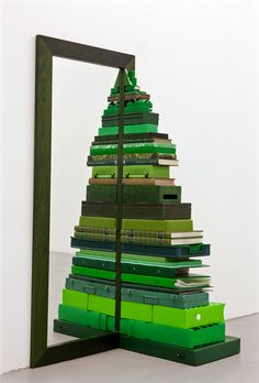 "Don't want to chop down a tree? Use a mirror and green books, boxes, and other small items around the home to create a one of a kind Christmas ""tree"""