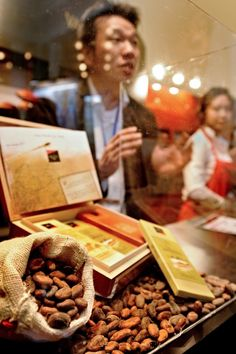 The cocoa crisis: why the world's stash of chocolate is melting away     A man talks to visitors at a stall of the Salon du Chocolat in Shanghai.