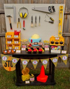 "We kind of fell in love with all of the desserts in this construction party. This party was ""built"" by Belinda from Styled By Belle to display the construction themed party invitations from Love JK. Using an old garden bench, spray paint and a piece of MDF board, Belinda created a tool bench to display the sweet …"