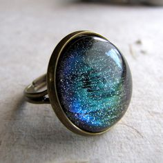 Northern Lights Ring in Antiqued Brass Color Changing Glitter Ring. $16.00, via Etsy.