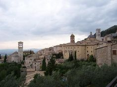 Assisi | Italy  Best known as the birthplace of St. Francis, Italy's patron saint, Assisi lies 90 miles north of Rome amid Umbria's rolling hills. The medieval town's must-sees include the Basilica of San Francesco, a grandiose sacred site built in 1230. It contains Giotto's 28 frescoes of St. Francis' life, the Romanesque Assisi Cathedral and the Baroque Church of St. Mary of the Angels.