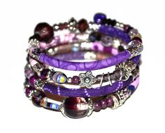 Purple, lilac and silver adjustable wrap bracelet with glass and handmade fabric beads on memory wire by PurpleTurtleStore on Etsy https://www.etsy.com/au/listing/187915111/purple-lilac-and-silver-adjustable-wrap