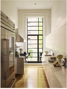 this is great, the way the window is extended up is such a simple technique to add more light and a bold focal point in a galley kitchen