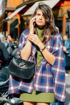 PFW - Plaids Coats | I've always wanted to make a coat like this where the sleeves are cut to make the arm hole near the front and the sleeves hang behind the arm. so cool! kind of like a cape coat