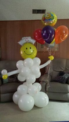 Get well nurse delivering a baseball to a 10 year old player.  Sculpture and bouquet by Balloons and Beyond.