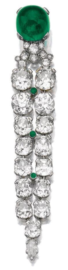 A fine Art Deco emerald and diamond pendant, 1930s. Set with a cabochon emerald…