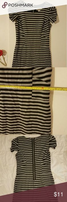 Stripped work dress Cute and stylish work dress. Great for fall. Stretchy material. Waist is 13 inches and length is 33 inches. It fits me too tight. Dresses