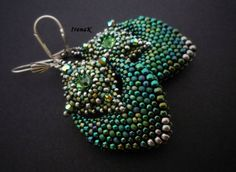 Earrings; or could be connector from strap/tube @ back of necklace to swag or other treatment for bottom of necklace