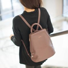 I have this bag in dark Brown. Its vegan and the lining of the bag is made out of 100% recycled plastic bottles