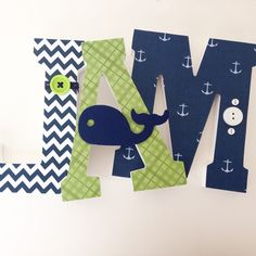 Navy blue and green nautical themed nursery letters with whale embellishment