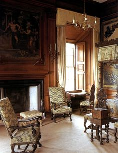 This image comes from the 14th century and identifies big paintings, drapes and long sleek chandeliers. A strong design element used is the tall curved occasional chairs. It's influenced by the petite chandelier and darks woods sharing the room with a fire place making a warm winter feel. It's inspiring because of the pattern on the chairs giving the room great texture.