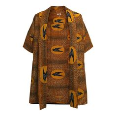 African Print Swallow Kimono: This jacket is made using a vibrant wax print fabric in London by BARÜCH. A oversized style, it has a wide collar and large sleeves. Also available in a Deco print.