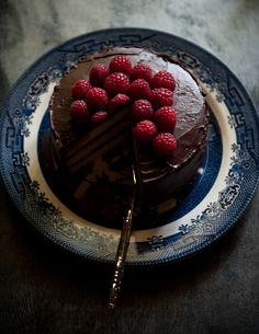 Coconut Chocolate Cake with Raspberries _ Makes one three-layer six-inch round cake (frosting recipe from the Scharffenberger chocolate book...