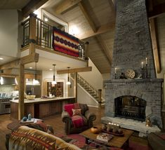 Rustic style home with an overlooking second story into the family room and large fireplace. Homeowners took advantage of the vaulted and tall ceilings. Redesigning your home?
