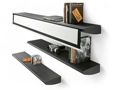 A projector screen that is hidden in a wall mounted book shelf- genius use of space!