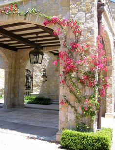 stone arched covered drive entrance